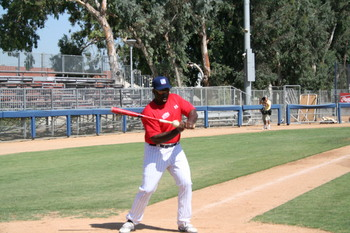 2008 RBI World Series - Day 2 - Coach Bishop hits the ball